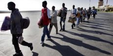 African immigrants from Mali walk towards a Moroccan passenger plane in Oujda, Morocco Thursday Oct.12, 2005. The immigrants who had been trying to reach Europe via Morocco, are being repatriated to Mali.    (AP Photo/Alvaro Barientos)